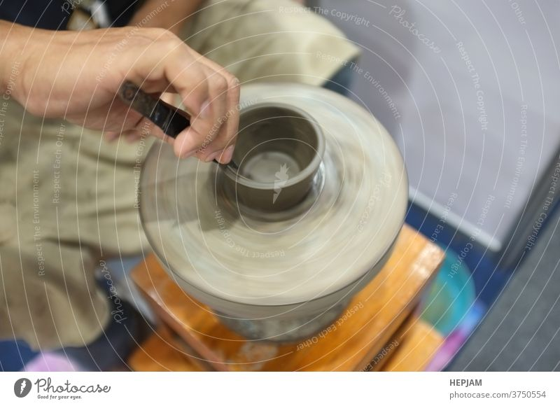 Concept Ceramic workshop. The man Throwing clay bowl on a pottery's wheel. art artisan banner ceramic circle concept cover design craft craftsman craftsperson