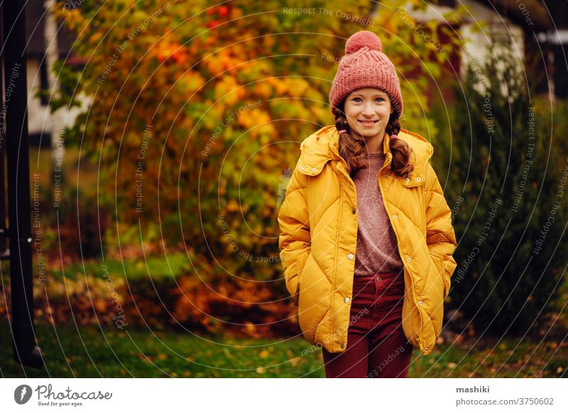 cute kid girl walking in autumn garden or park, wearing warm stylish clothes child season fun nature outdoor joy happy childhood gardening leaf outside playing