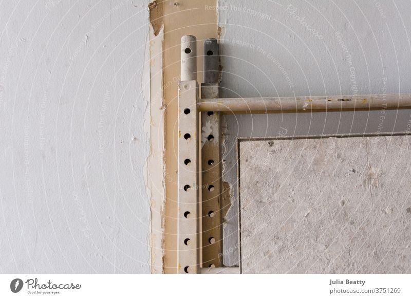 White interior room remodel construction site Construction site construction equipment drywall paint Painter repair updraft remodelling dirty Metal Ladder
