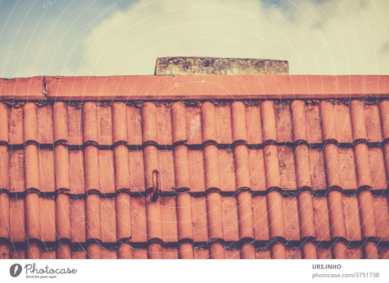 a bit of chimney sticks out from the tiled roof Roof brick roof area cloud Roofer Roofing company Orange Roofing tile series linear Old Red Chimney towering