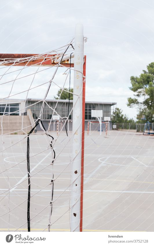 an empty school yard soccer goal net education back to school elementary primary educational no people elementary school playground sport game football nobody