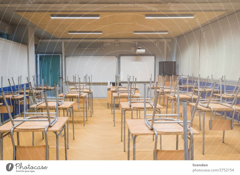 Empty school - due to corona virus COVID-19 education class back to school classroom elementary indoor desk primary knowledge learn pandemic safety educational