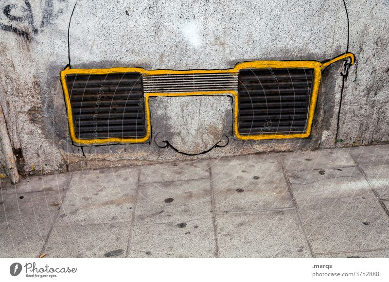 Art on building   silent observer Wall (building) Concrete Wall (barrier) Gray Vent slot Ventilation shaft Graffiti Whimsical Eyeglasses Person wearing glasses