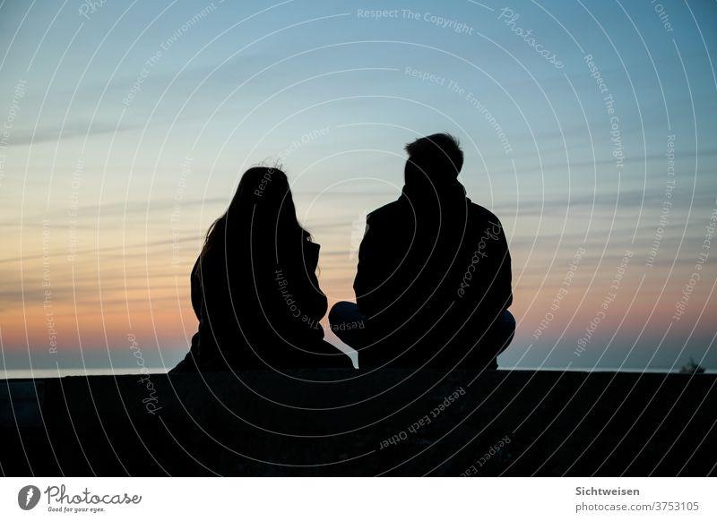Two people at sunset Sunset Sky Horizon Dusk Orange
