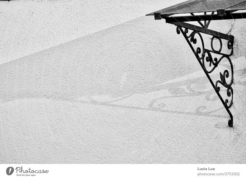 an old fashioned canopy and its shadow, black and white Canopy Art nouveau Shadow Black & white photo Architecture Deserted Facade Exterior shot built Light