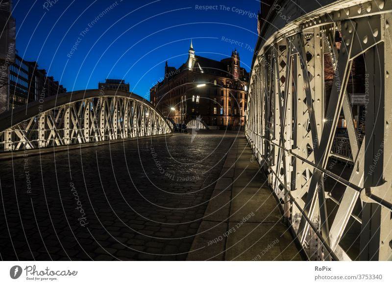 Historical bridge in the Speicherstadt of Hamburg. storehouse city Harbour Depot Channel urban Elbe built Architecture River Night Light Low tide canal locks