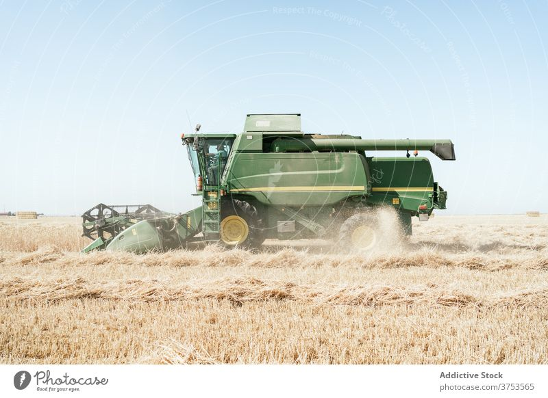 Agricultural machine in filed in summer harvest combine collect field wheat countryside machinery farm agriculture season rural nature meadow farmland