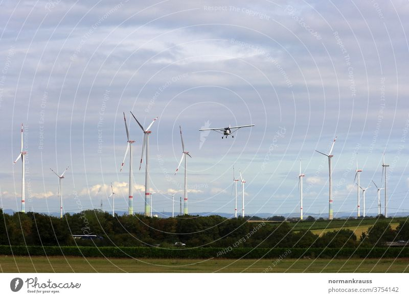 Small aircraft and wind turbines Light aircraft wind farm windmills Airplane Flying approach landing approach wind power Power Generation eco-power ecology