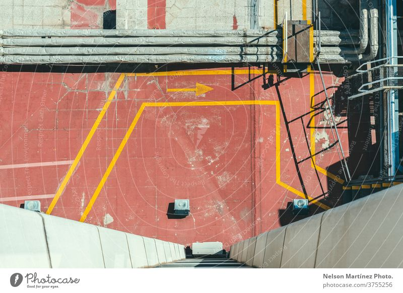 Top view of a roof with lines and geometry in an industrial area. interior design space geometric background structure building modern light abstract wall
