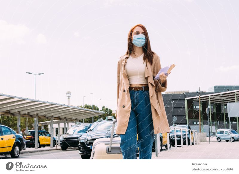 young woman with luggage arrives at the train station by cab coronavirus voyage traveling transportation public journey tourist trip commuter economy epidemic