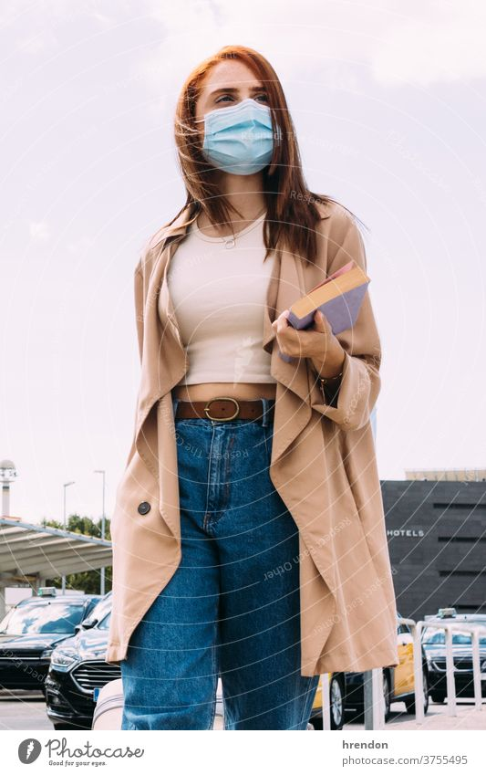 young woman with luggage arrives at the train station by cab coronavirus outbreak journey transport traveling public tourist trip commuter transportation voyage