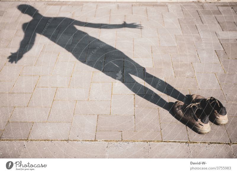 Shadows and shoes - a shadow of its own Shadowy existence Invisible Shadow play shadowy Human being Vanished Soul Man Dark side shady world Magic Footwear