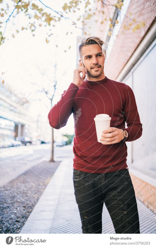 Man talking on the phone outdoors. mobile person adult man male cafe young people coffee handsome happy cell attractive call technology casual lifestyle urban