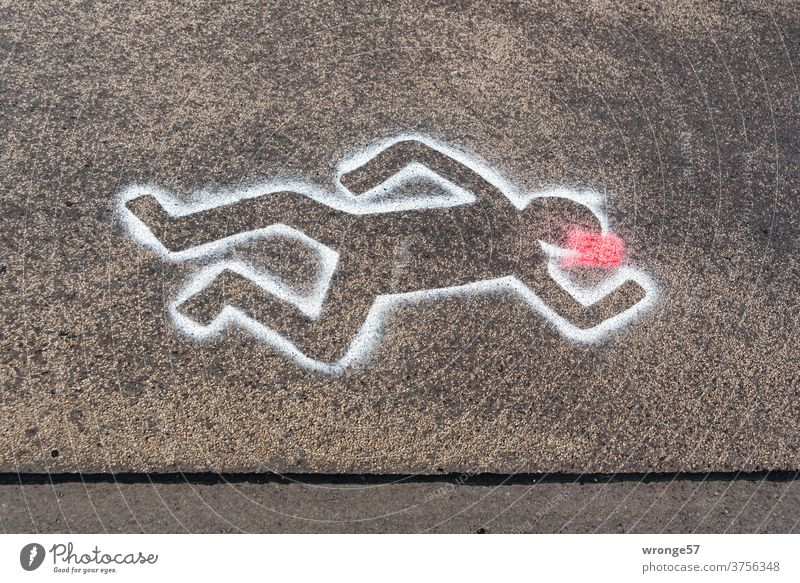 Crime scene road | outlines of a person lying on the road marked with white spray paint on black asphalt Street Asphalt white color silhouettes sketched Lie