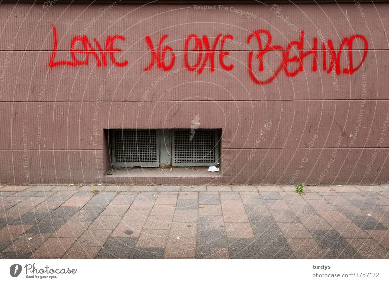 Leave No One Behind, sprayed writing on a house wall. refugees, migrants, disadvantaged, humanity Refugee leave no one behind Migration Humanity Moria Migrants