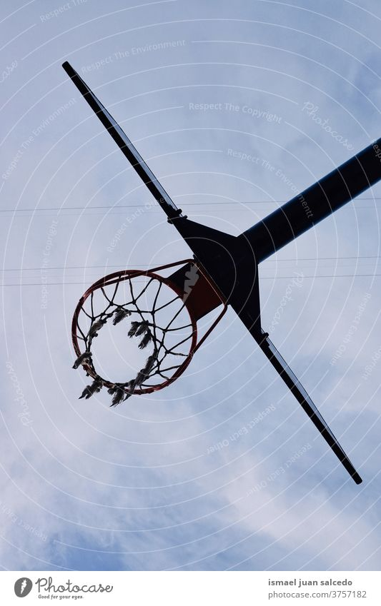 street basketball hoop in Bilbao city, Spain sky blue silhouette circle chain metallic net sport sports equipment play playing playful old park playground