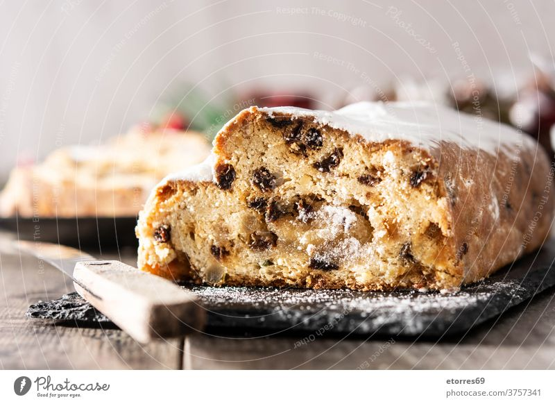 Christmas stollen fruit cake on wooden table. almond bakery celebration christmas delicious dessert food german german dessert holiday homemade marzipan pastry