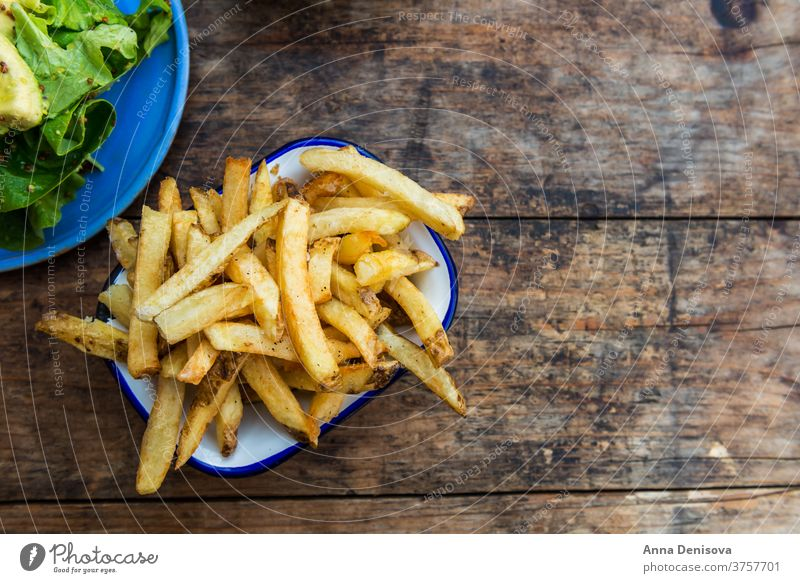French Fries with Avocado and Mustard Salad fries french potato chips avocado salad leaves food yellow snack fast fry wooden golden eat meal delicious tasty