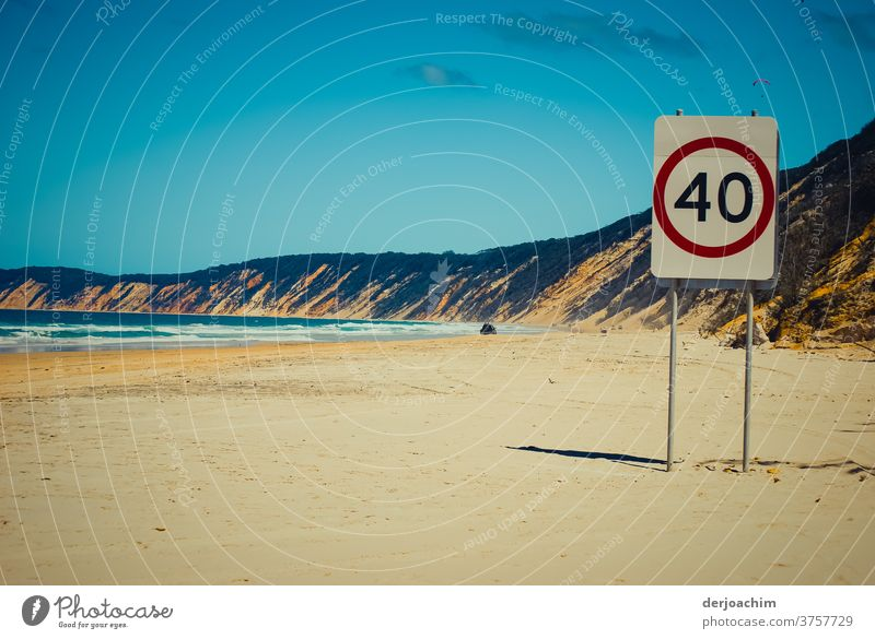 Maximum speed - 40 km - on a stretch of beach . On the left the blue sea and on the right a high bank. In the distance on the beach you can see a car. coast