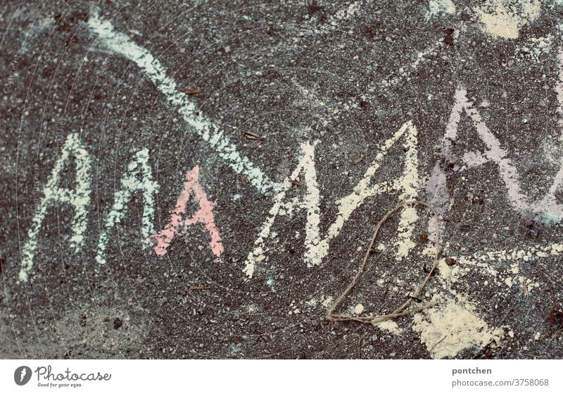 The letter A is written with chalk on asphalt. Start of school, A-doctor's appointment learn to write start of school street chalk Write Child Characters
