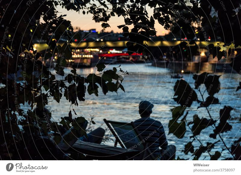 On the banks of a big river you can experience a romantic sunset in the middle of the city Beach bar deckchairs Evening clearer City Vienna Herrmanns