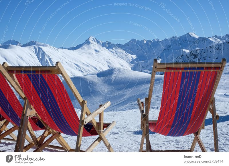 three deckchairs red-blue in a winter landscape Deckchair Red Blue Striped Winter Winter vacation Winter mood Snow Colour photo Exterior shot Snowscape Nature