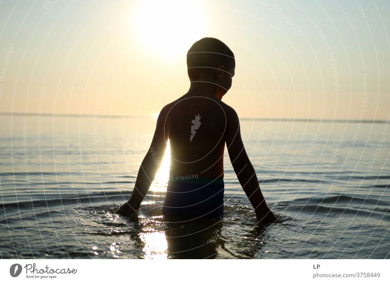 contrast silhouette of a child against sea and sky Contrast Shallow depth of field Silhouette Shadow Light Day Exterior shot Action Body Boy (child) Human being