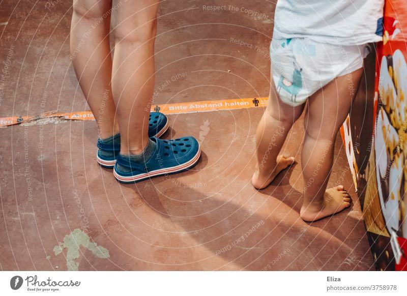 Children and distance marking children gap keep sb./sth. apart Toddler Summer corona guard sb./sth. covid-19 coronavirus