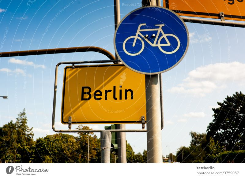 Berlin with bicycle path Corner Lane markings Bicycle Cycle path Clue edge Curve navi Navigation Orientation Arrow Wheel cyclists Right Direction Outskirts