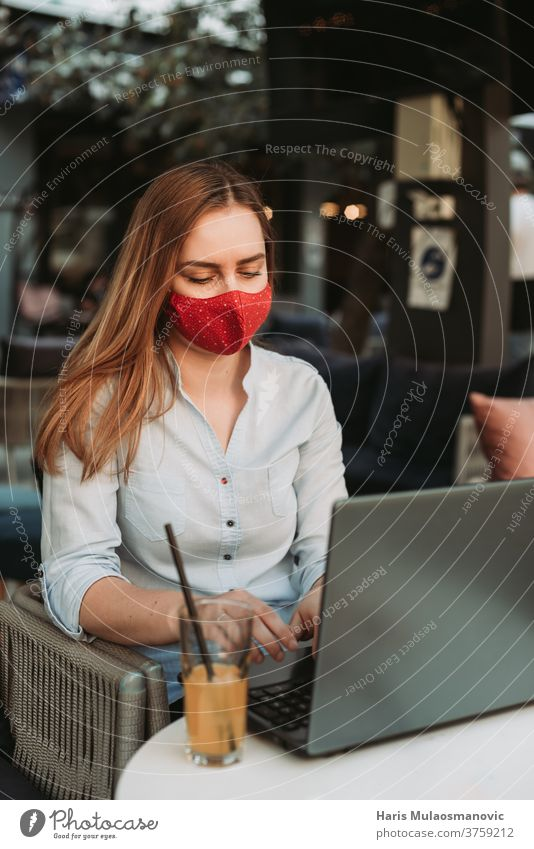 Blonde woman with mask working on laptop in coffee shop adult attractive beautiful beauty business businesswoman cafe caucasian communication coronavirus
