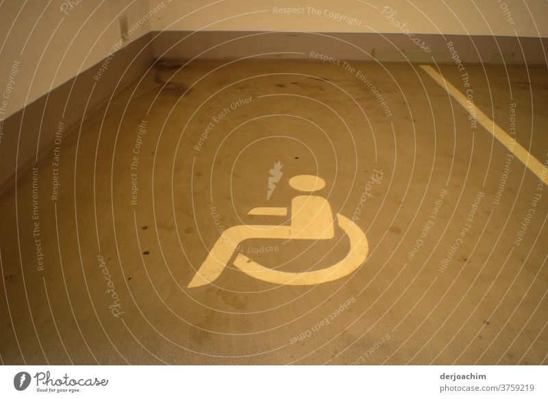 Reserved for the disabled is the parking space in the underground garage. With a lying wheelchair picture drawn on the floor. garage entrance Parking garage