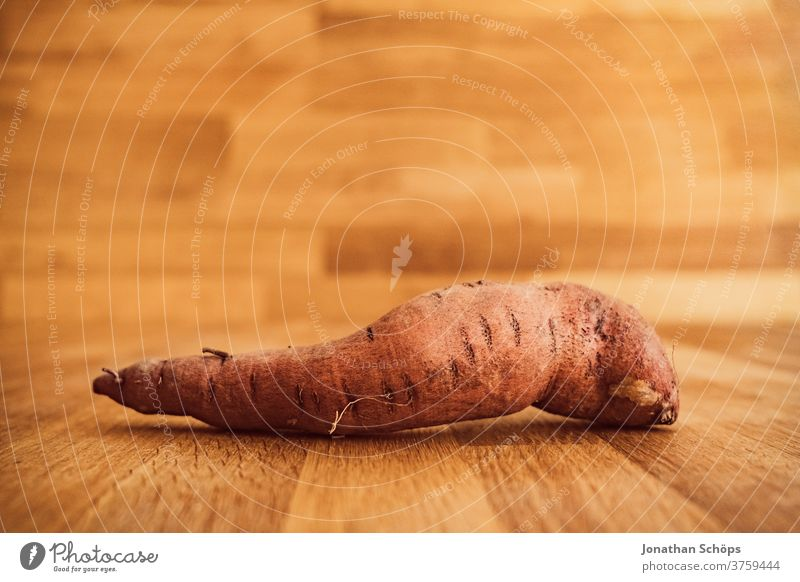 sweet potato still life close-up in front of wood Harvest thanksgiving Thanksgiving Vegetable Autumn wooden background Wooden table food Holiday season
