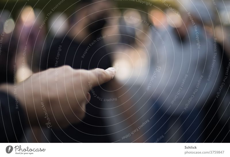 hand points with index finger at completely blurred person - point with finger at someone by hand Indicate Forefinger Blur Human being shallow depth of field