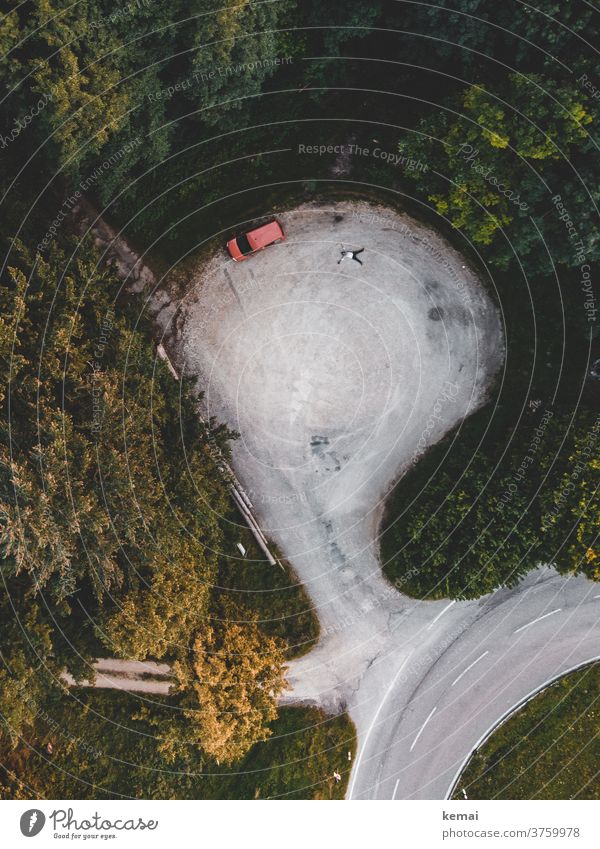 Car and man from above car Caddy Camping Wild camping Lie Parking lot Human being snow angels surface UAV view Bird's-eye view Forest green tree Nature