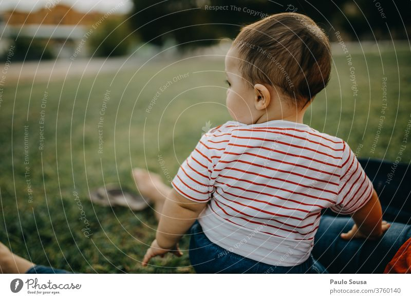 Toddler sitting on the grass looking away Child Grass Spring Spring fever Summer Summer vacation Happiness Day Human being Infancy Colour photo Meadow Flower