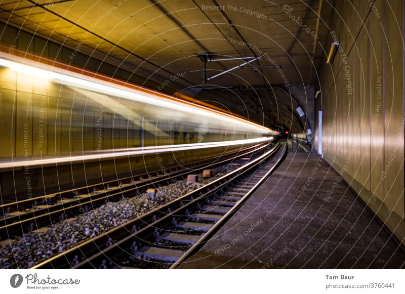 Subway in the tunnel on rails, light strips show speed of the train in the tunnel as long time exposure Speed Underground Local traffic Commuter trains Tram