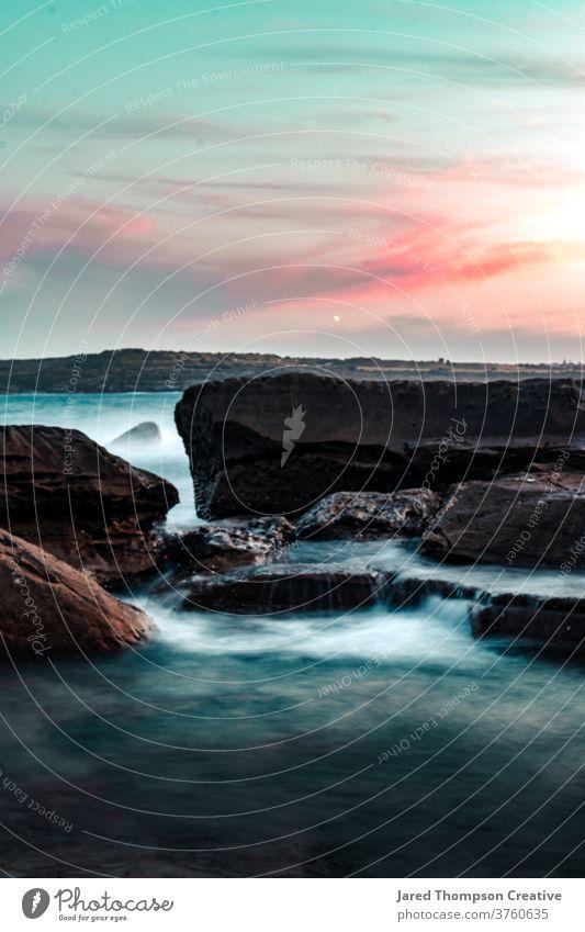 Waves crash over rocks during sunset at Marourbra in Sydney, Australia ocean pink spring australia nsw newsouthwales eastcoast beach summer blue Swimming pool