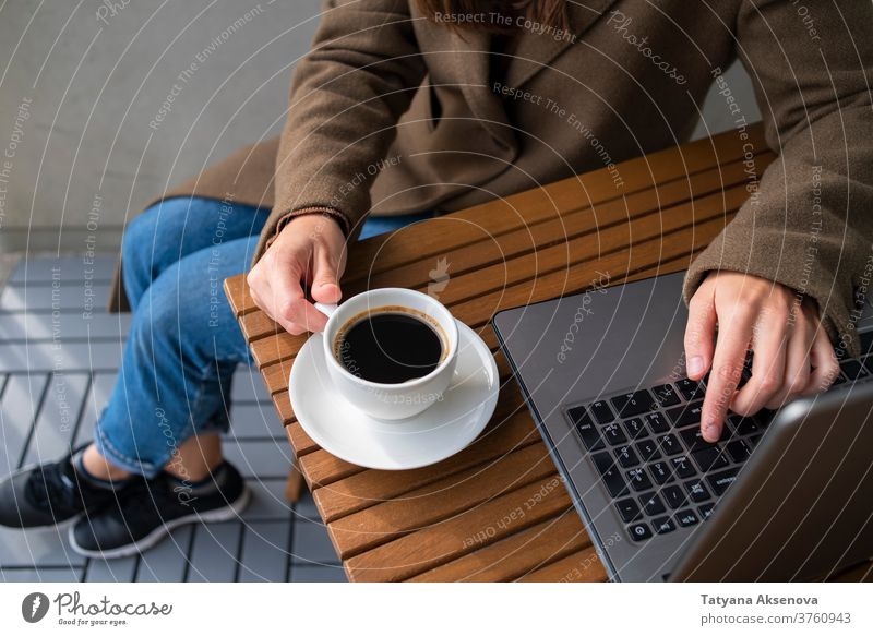 Woman working in street cafe with laptop computer coffee internet person technology female business table modern woman cup lifestyle sitting using people women