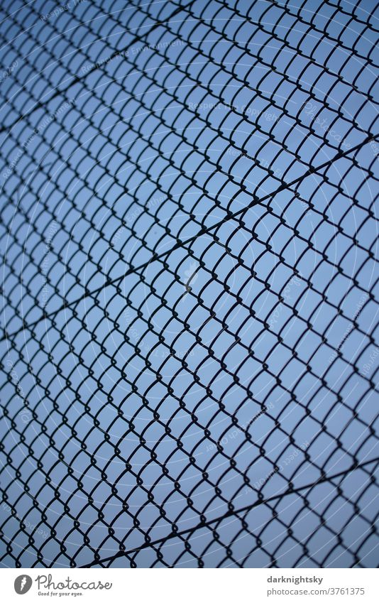Mesh wire fence and blue sky in the evening Fence Barrier green Things Field Exterior shot Border Deserted Sky Nature Grating Barbed wire Threat Safety