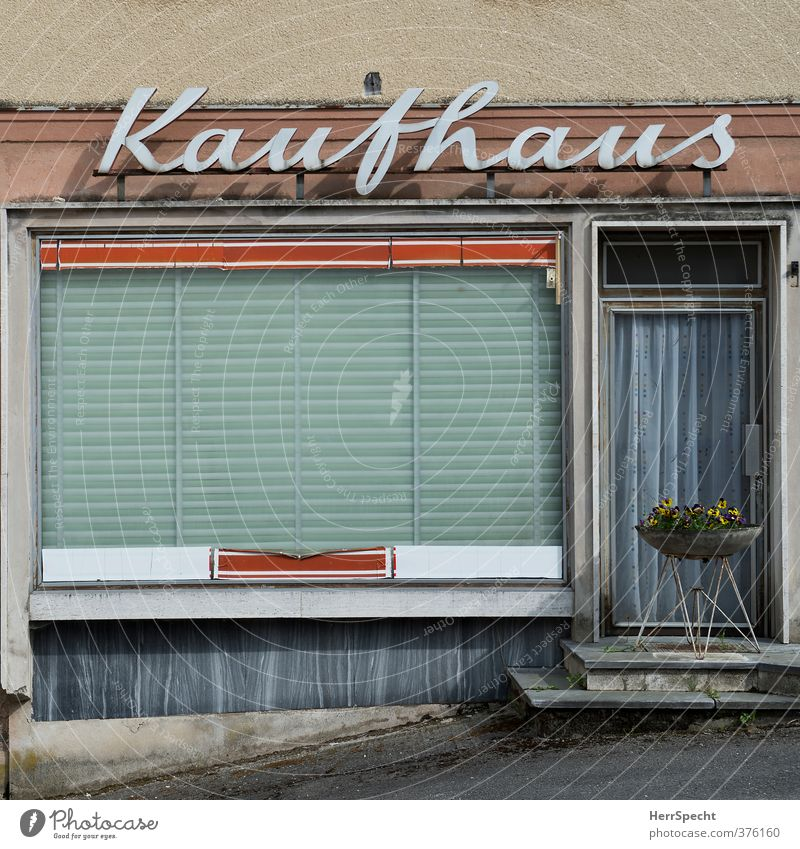 shopping paradise Shopping Design House (Residential Structure) Building Wall (barrier) Wall (building) Facade Window Old Retro Trashy Gloomy Sadness