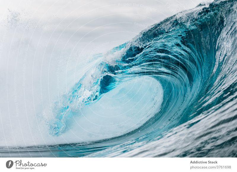 Stormy turquoise sea with waves ocean power water nature landscape blue seascape coast surf tropical crest summer splash white foam seashore surface storm wet