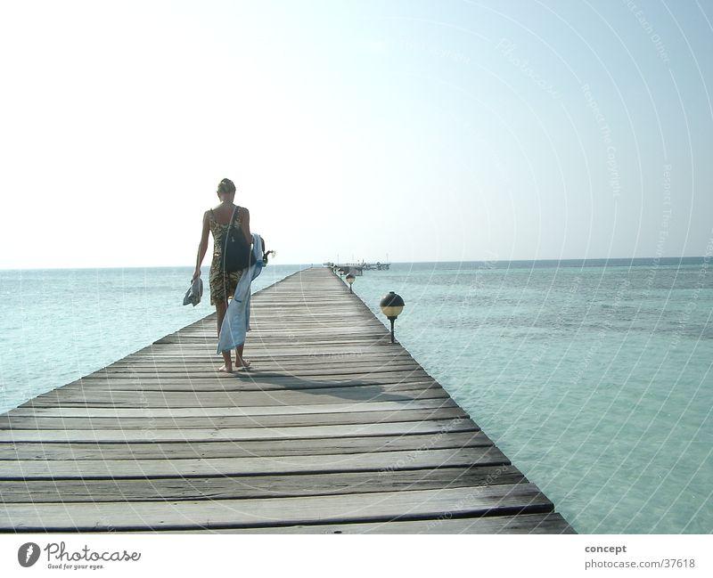 footbridge into the sea Footbridge Beach Ocean Maldives Summer Woman blue water