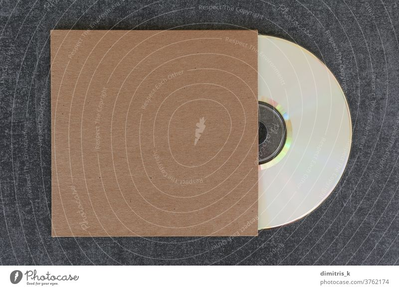 blank compact disc cd and generic cardboard sleeve mockup dvd cover white label brown template copy-space design cdr empty background music audio data digital