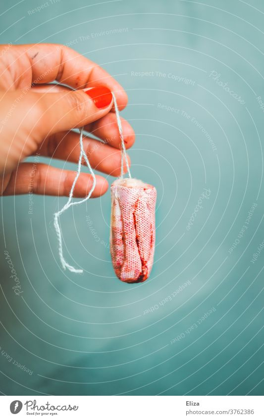 No Taboo - A female hand holding a bloody tampon. Tampon Menstruation real Blood Cycle feminine Red naturally reality bled to death bleeding menstruating