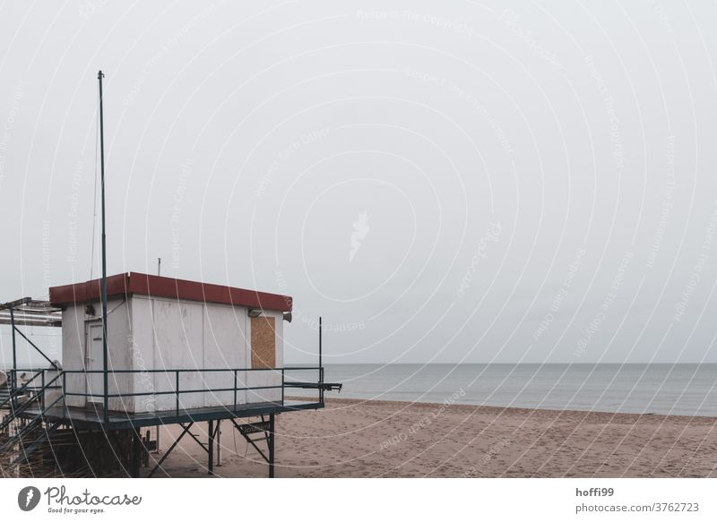 a gloomy day by the sea rescue tower Autumn Lifeguard Bay watch Safety Tower Pool attendant Sand Island Beach Ocean coast Hunting Blind Water Surf Swell