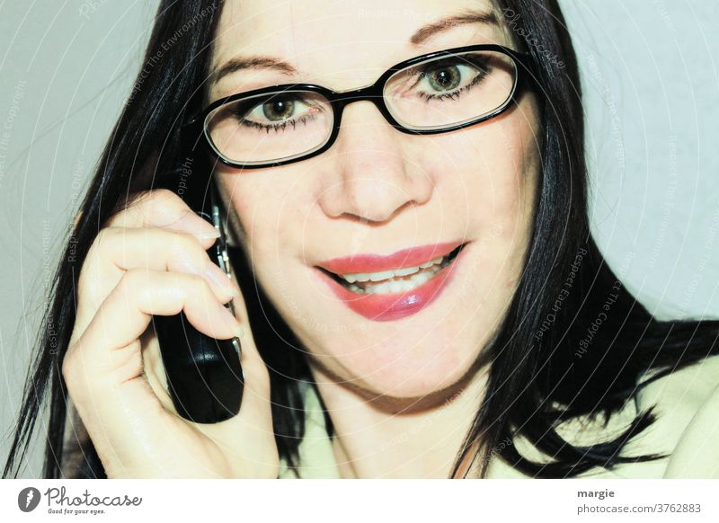 A woman with glasses on the phone Woman Young woman Feminine Face of a woman Telephone To call someone (telephone) Receiver Cellphone Eyeglasses