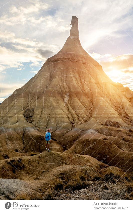 Male traveler in Bardenas Reales in summer bardenas reales man dried soil amazing scenery hill formation natural male navarra spain rocky nature landscape