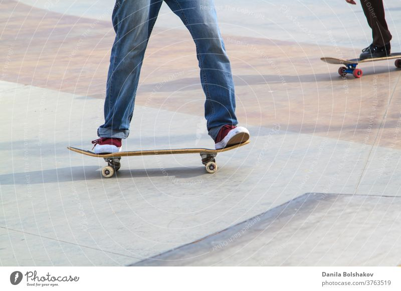 Young man practising on skateboard in skate park action active athlete athletic boarding boy casual contest culture deck dynamic energy extreme extreme sports