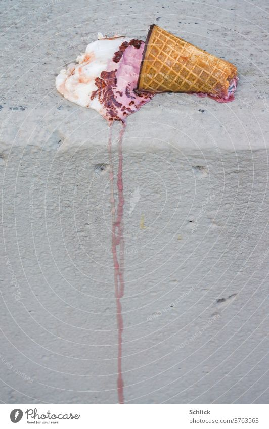Ice cream in a bitten waffle melts carelessly on a grey wall Waffle Melt Wall (barrier) Gray Summer Work of art Flow deliquesce jettisoned Lie bitten into ardor