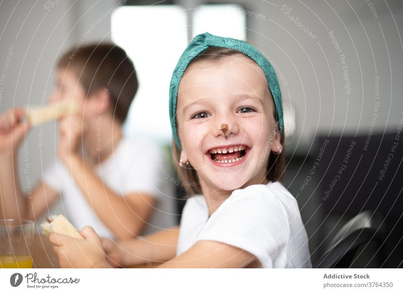 Siblings eating chocolate bread girl boy excited child amazed children cheerful food preteen optimistic positive breakfast mouth fun female sweet happy young